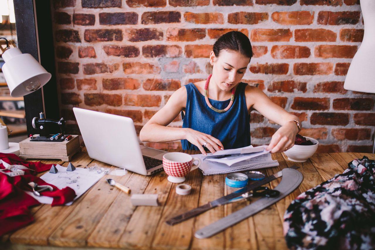 Brick Wall Businesswoman Coffee Creative Designer  Fashion Laptop Office Paperwork Ruler Technology