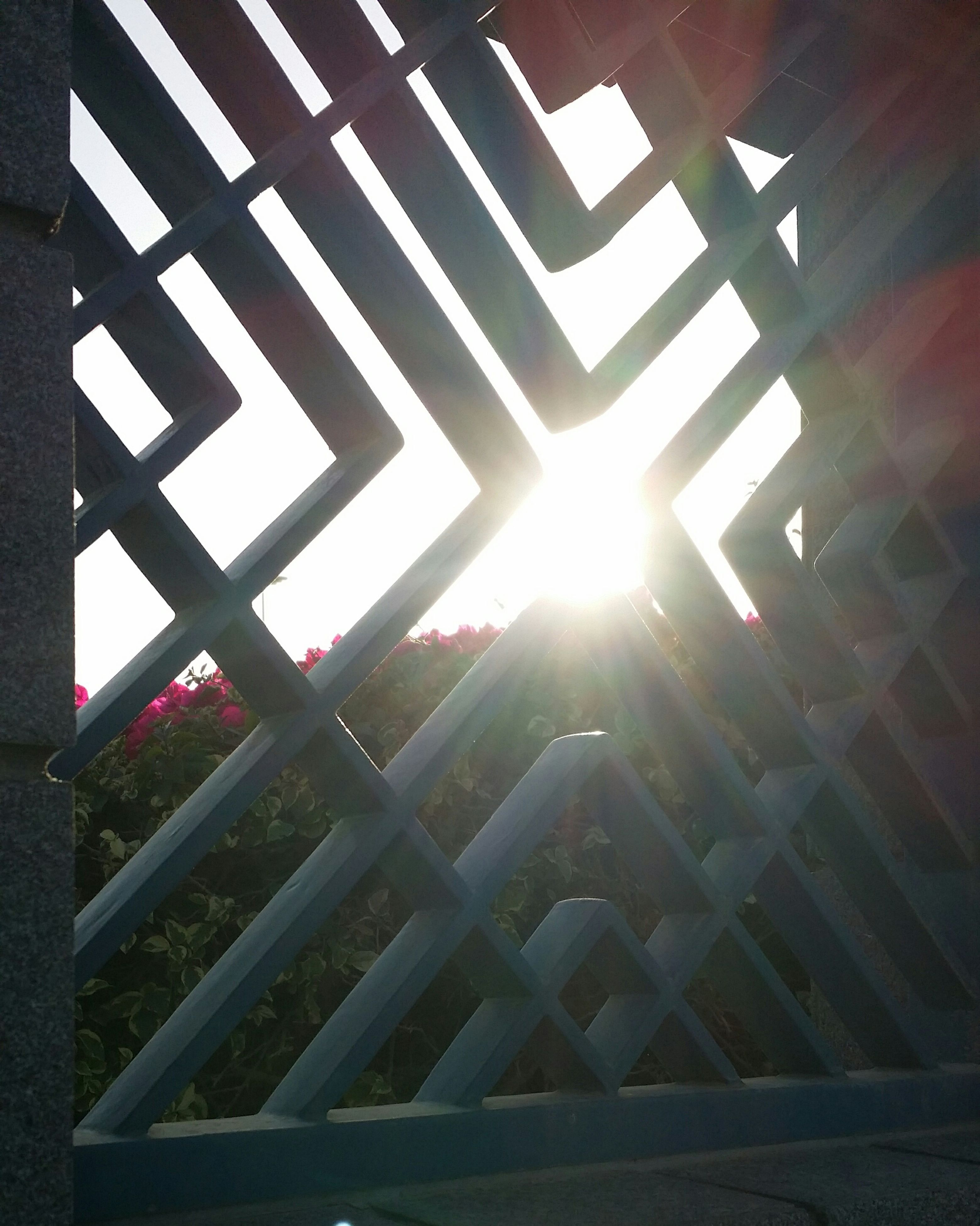 sun, sunlight, sunbeam, lens flare, built structure, shadow, architecture, low angle view, indoors, sunny, sunset, railing, pattern, no people, day, bright, building exterior, wood - material, steps