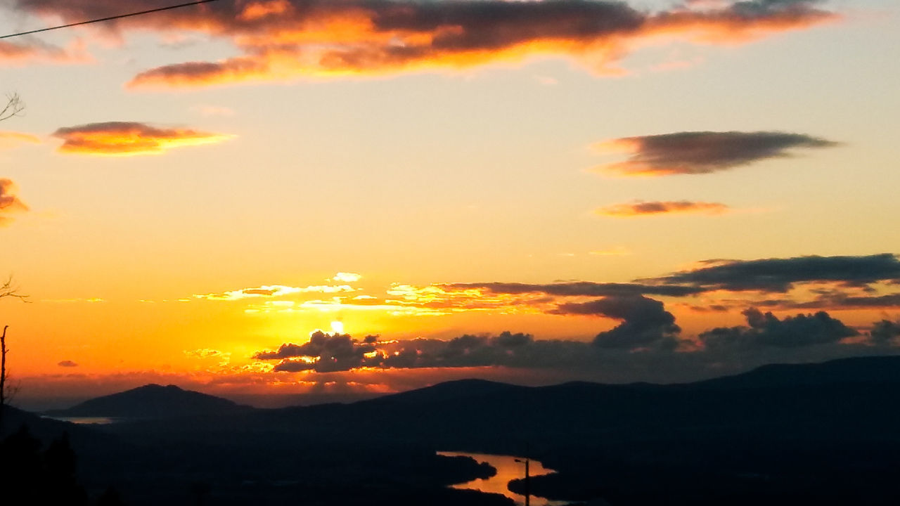 sunset, orange color, sky, silhouette, beauty in nature, nature, scenics, cloud - sky, no people, tranquility, tranquil scene, mountain, outdoors, sun, landscape