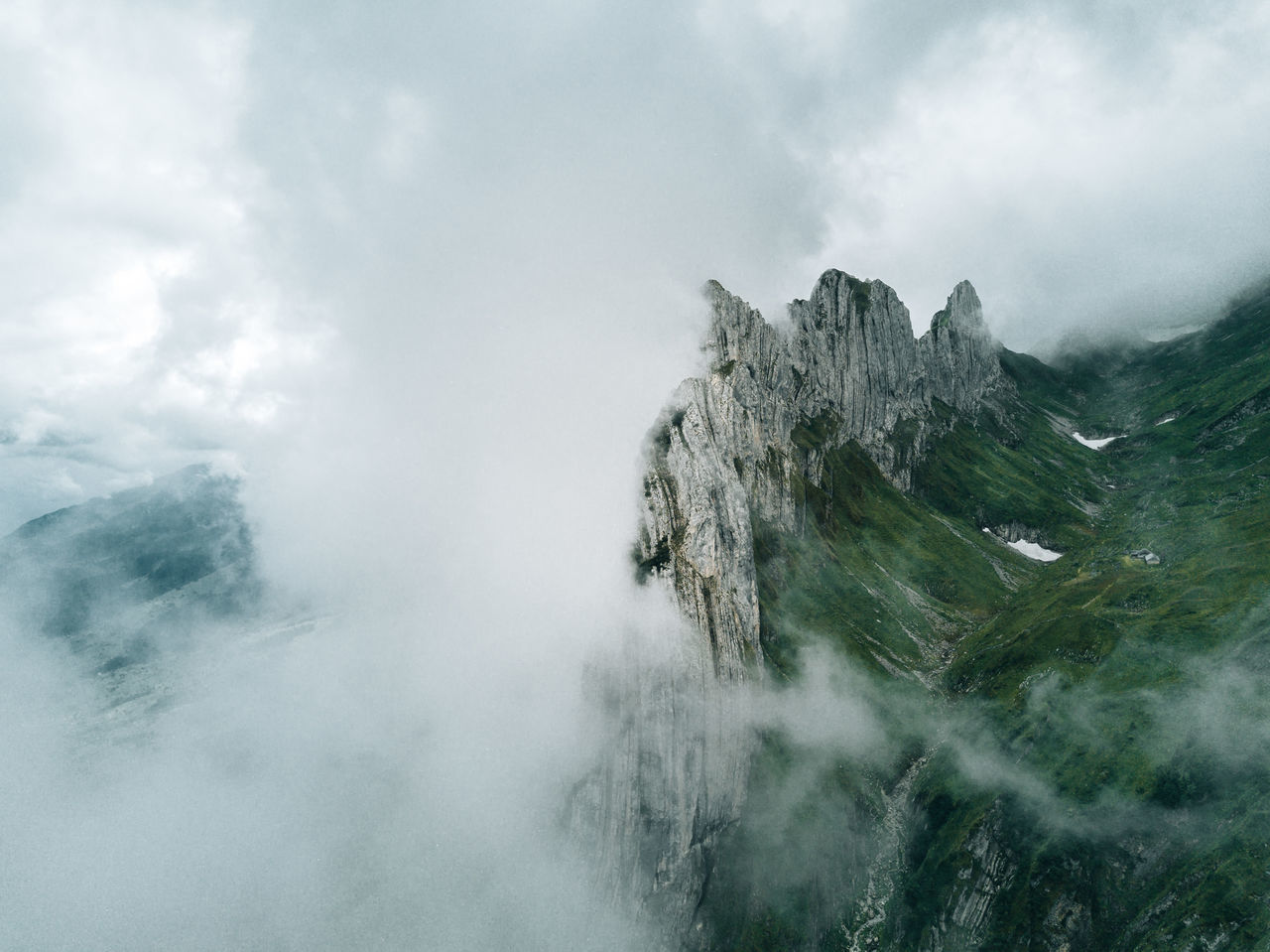 Switzerland Mountain range clouded with fog Beauty In Nature Day Fog Landscape Mountain Mountain Range Nature No People Outdoors Scenics Sky Weather