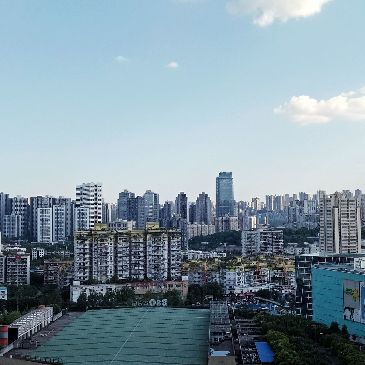 architecture, skyscraper, city, building exterior, built structure, cityscape, day, sky, outdoors, no people, urban skyline, modern, tree