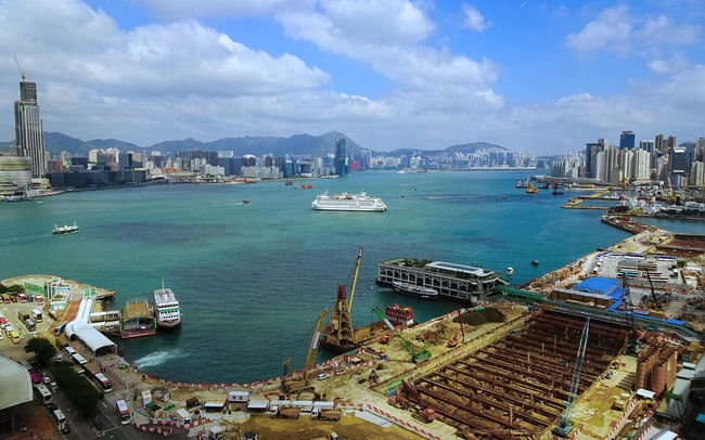Architecture Business City Cityscape Cloud - Sky Commercial Dock Construction Day Harbor High Angle View HongKong Horizontal Industry Mode Of Transport No People Outdoors Sea Ship Shipping  Sky Skyscraper Transportation Travel Destinations Urban Skyline Water
