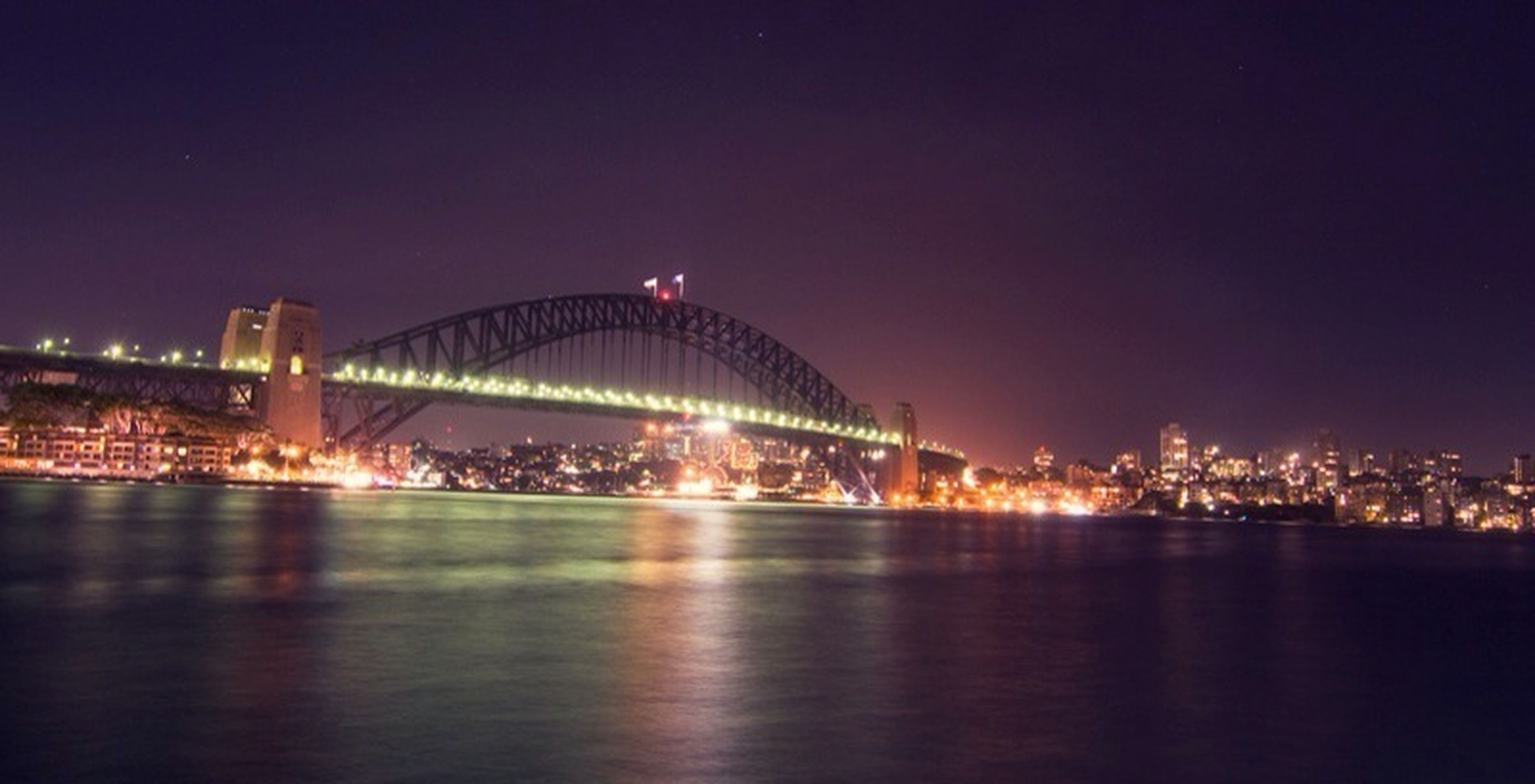 illuminated, night, architecture, built structure, bridge - man made structure, connection, water, city, river, waterfront, engineering, travel destinations, sky, reflection, famous place, bridge, capital cities, cityscape, copy space, travel