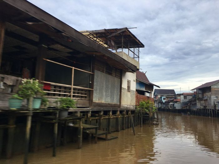 """""""Indonesia In My Eye"""" Architecture Building Exterior Water Built Structure Sky Reflection Outdoors Table No People Day Sunday Morning Borneo Island Banjarmasin Iphone6splus Transportation IPhoneography Activity -Martapura River-"""