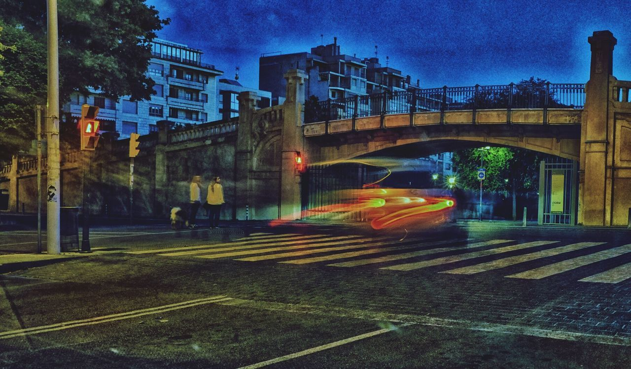 transportation, architecture, built structure, city, connection, street, blurred motion, building exterior, motion, speed, illuminated, city life, road, outdoors, night, no people, sky
