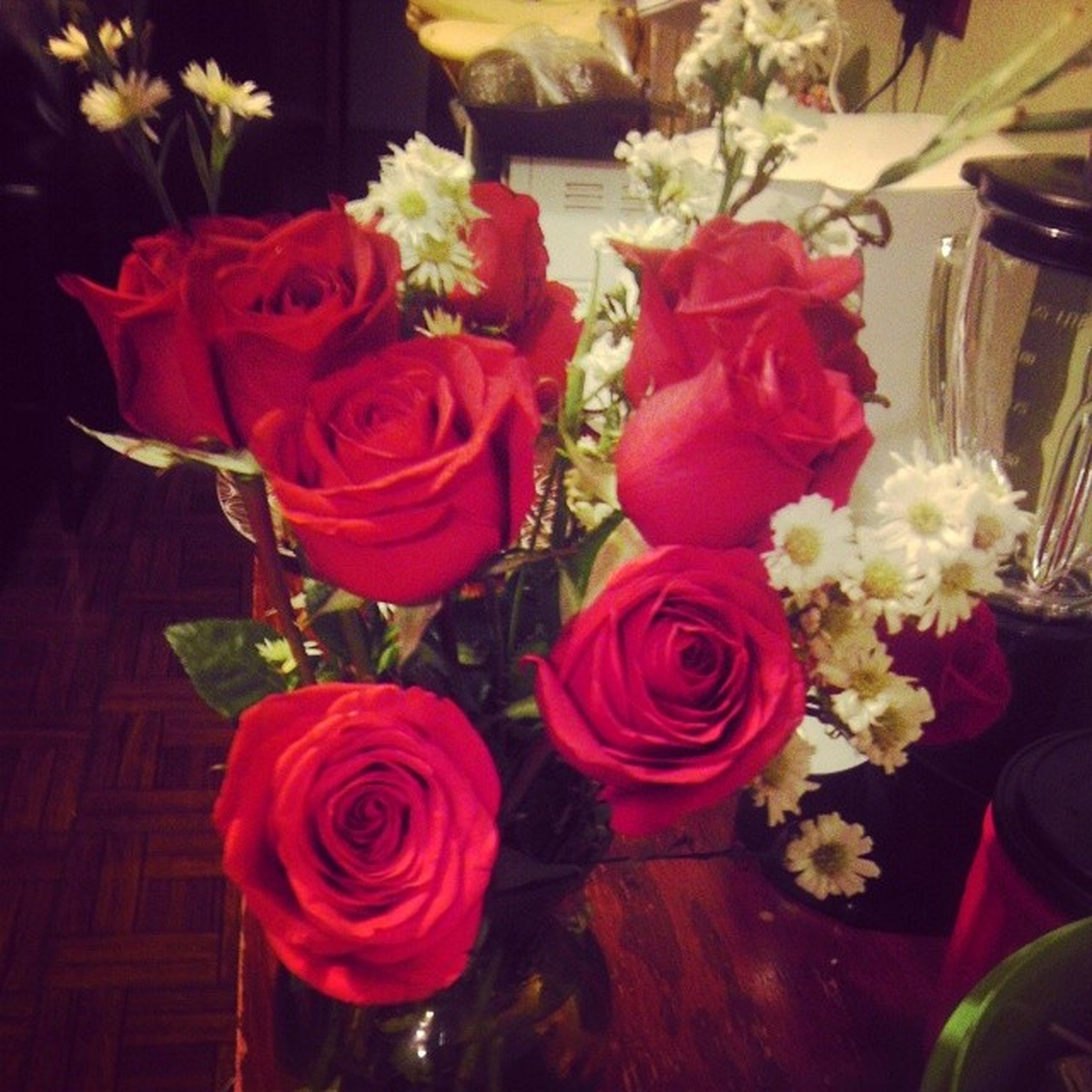 flower, rose - flower, indoors, petal, freshness, flower head, fragility, vase, bouquet, flower arrangement, rose, beauty in nature, bunch of flowers, table, pink color, close-up, decoration, red, high angle view, multi colored