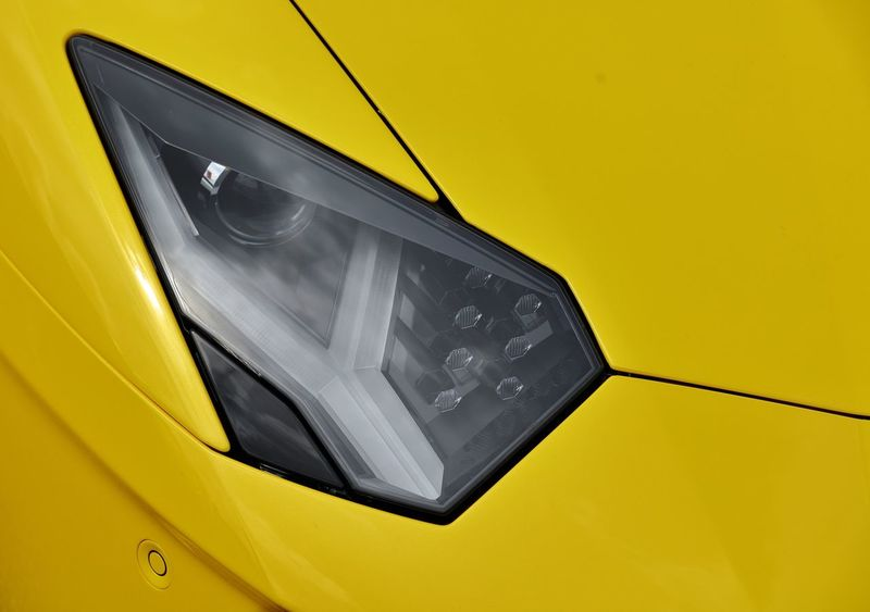 A Close Up Detail Of A Lamborghini Aventador SV Headlight, With Its  Designed Style Giving