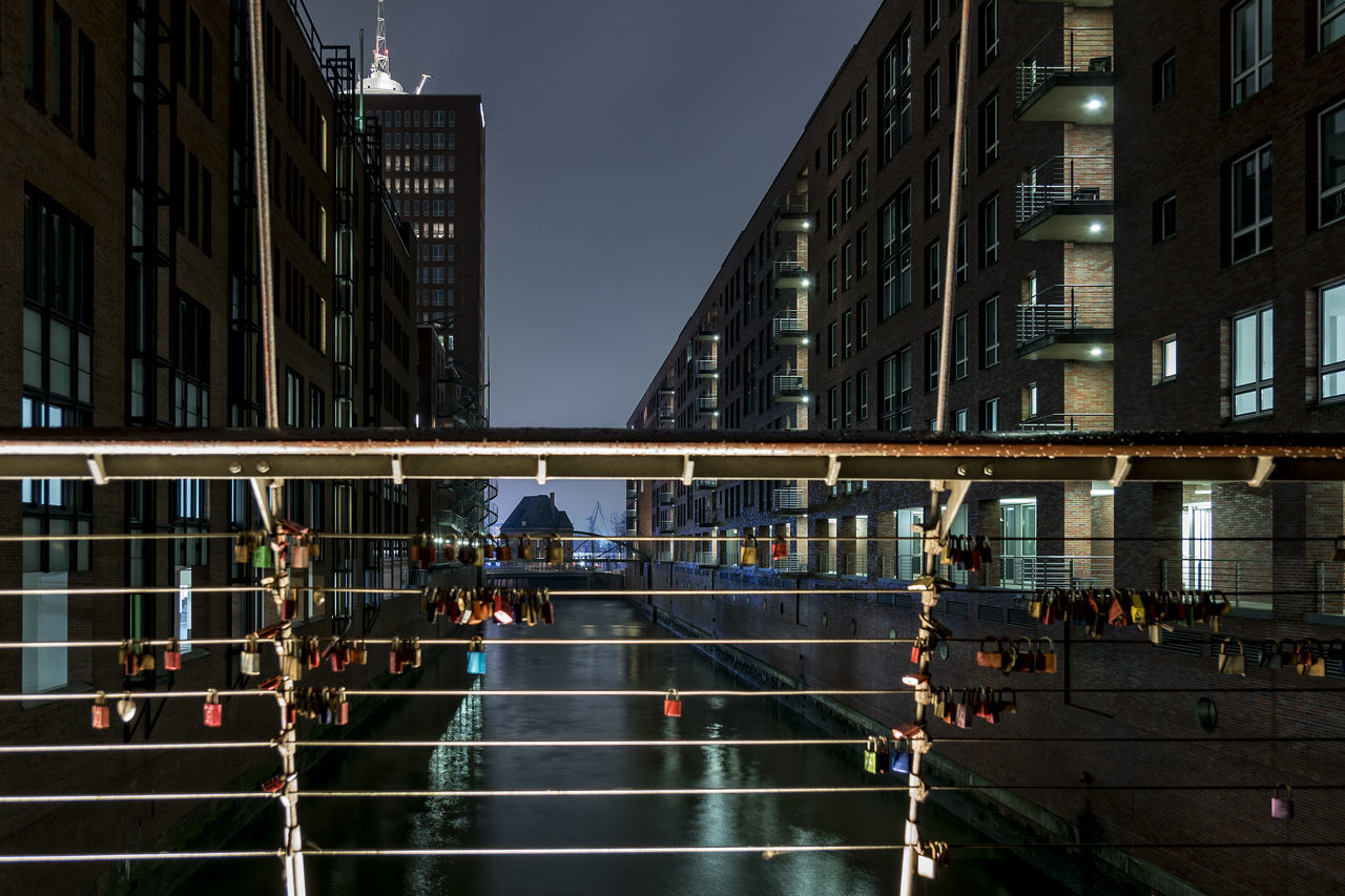 Fleet Speicherstadt Hamburg Adapted To The City City Fleet Hafencity Hamburg Hamburg Harbour Illuminated Night North Germany Old And New Buildings Outdoors Padlocks On Bridge Railing Real People Sky Speicherstadt Hamburg Speicherstadt Hamburg Urban Skyline Water Reflections