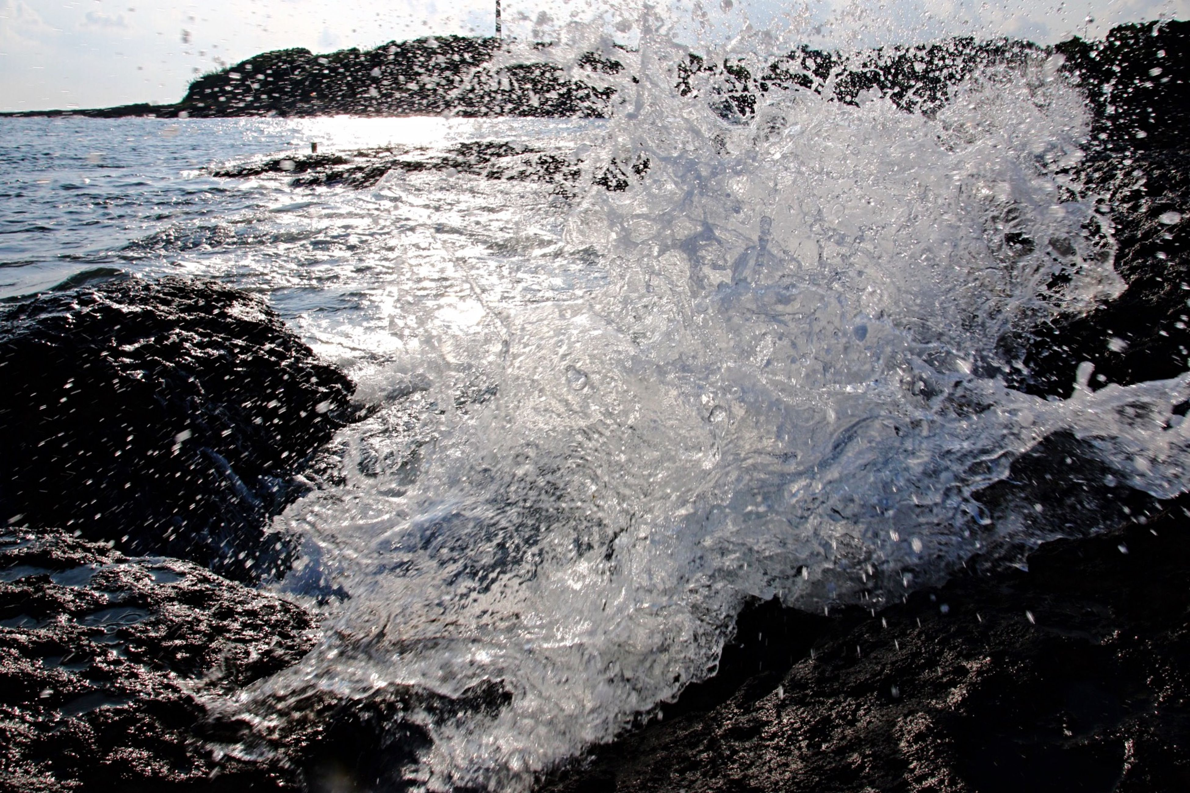 water, sea, splashing, surf, wave, motion, nature, rippled, high angle view, waterfront, beauty in nature, rock - object, wet, shore, day, scenics, outdoors, tranquility, beach, sunlight
