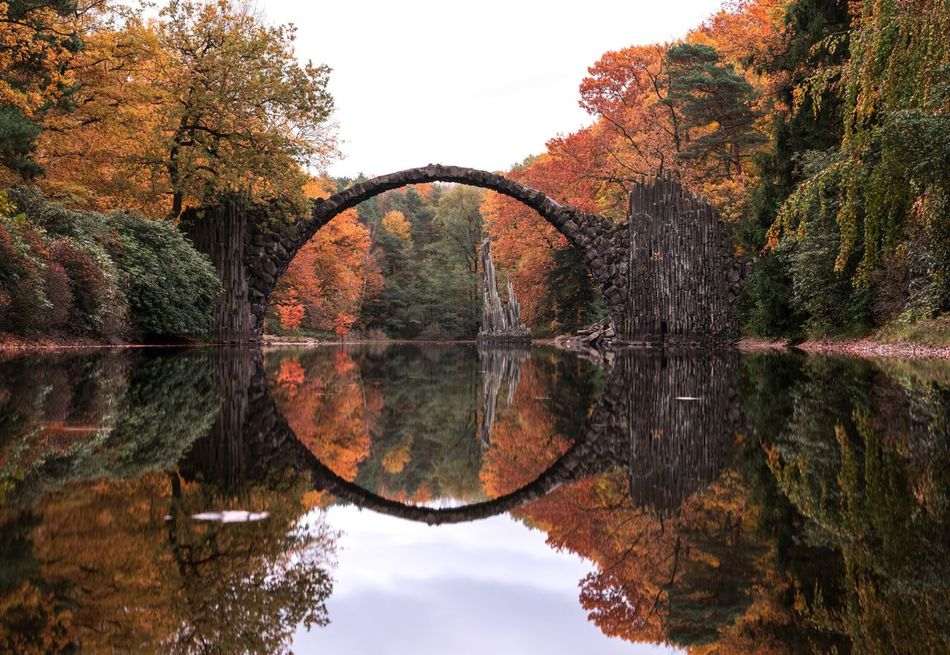 Double Fall. Reflection Tree Water Nature Symmetry Tranquility No People Waterfront Autumn Scenics Day Outdoors Standing Water Beauty In Nature Sky Forest Fall Rakotzbrücke Rakotzbridge Devils Bridge Germany Natural Beauty Nature On Your Doorstep Deutschland Symmetrical