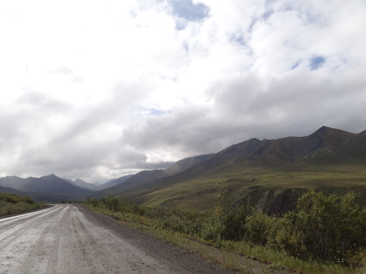 Beauty In Nature Canada Cloud - Sky Day Dempster Highway Grass Landscape Mountain Mountain Range Nature No People Outdoors Road Scenics Sky The Way Forward Tombstone Territorial Park Tranquil Scene Tranquility Transportation Yukon