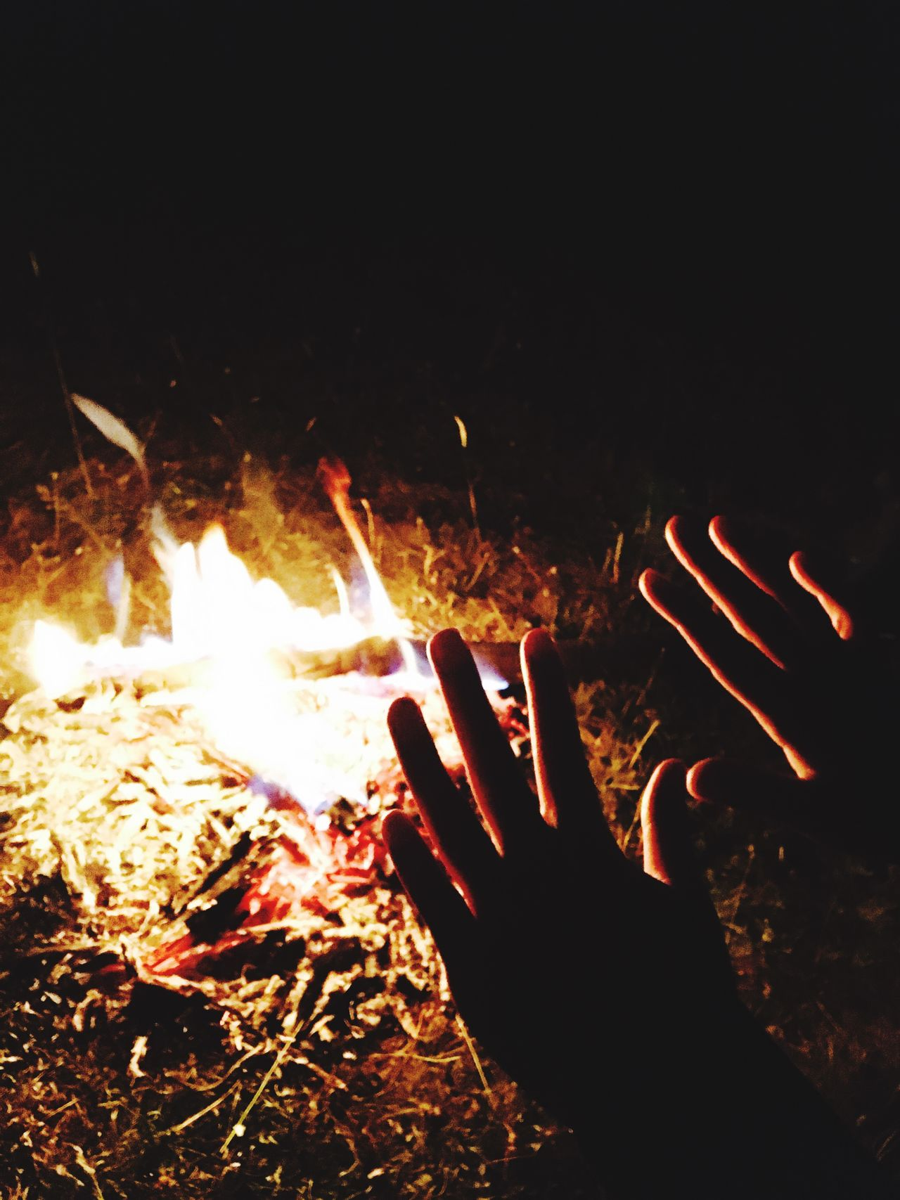 EyeEm Selects EyeEmNewHere Fire - Natural Phenomenon Flame Burning Heat - Temperature Human Hand Glowing Night Bonfire Human Body Part Fire Campfire One Person Real People Outdoors Fire Pit Men Close-up Inferno People Firework Neon Life