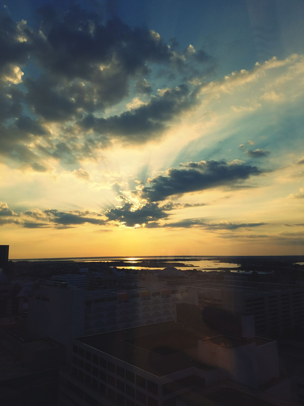 Sunset Sea Cloud - Sky Water Sky Horizon Over Water Beach Scenics No People Tranquility Travel Destinations Outdoors Sunlight Sun Nature Beauty In Nature Summer Vacations City Multi Colored Window Scenic From The Window