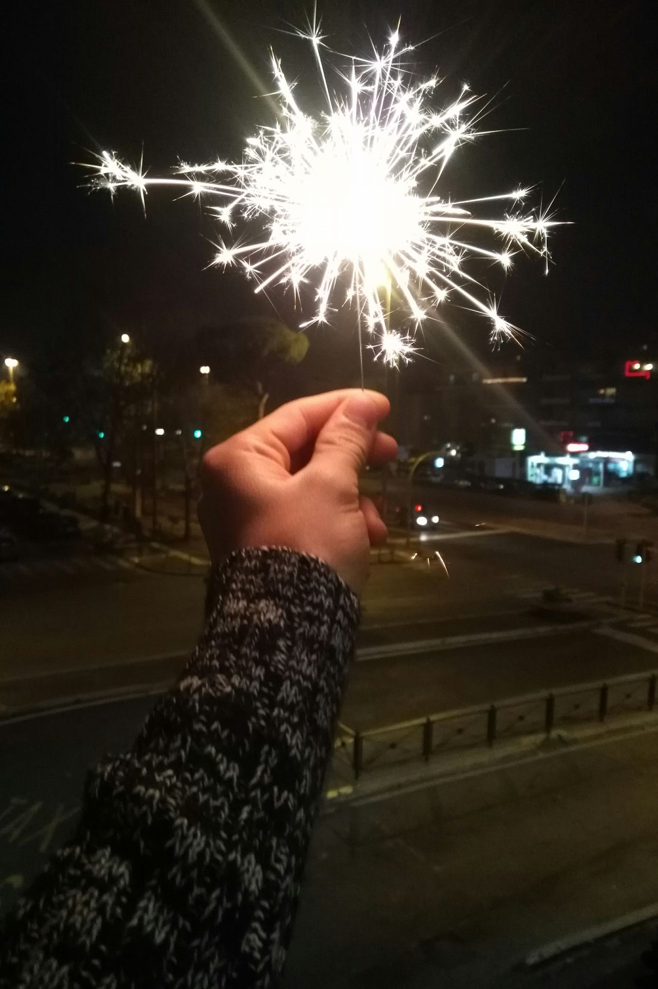 Illuminated Firework - Man Made Object Firework Display Human Hand Night Celebration Sparks Arts Culture And Entertainment Outdoors One Person Human Body Part Sky Motion Exploding Adults Only People Adult Nature Beauty In Nature Clear Sky Relaxing Wave Splashing Scenics Storm Cloud