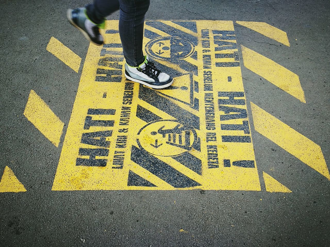 Walking on Signage at Railwaystation Streetphotography Passenger Jakarta Commuterline Enjoying Life Sneakers Outdoors