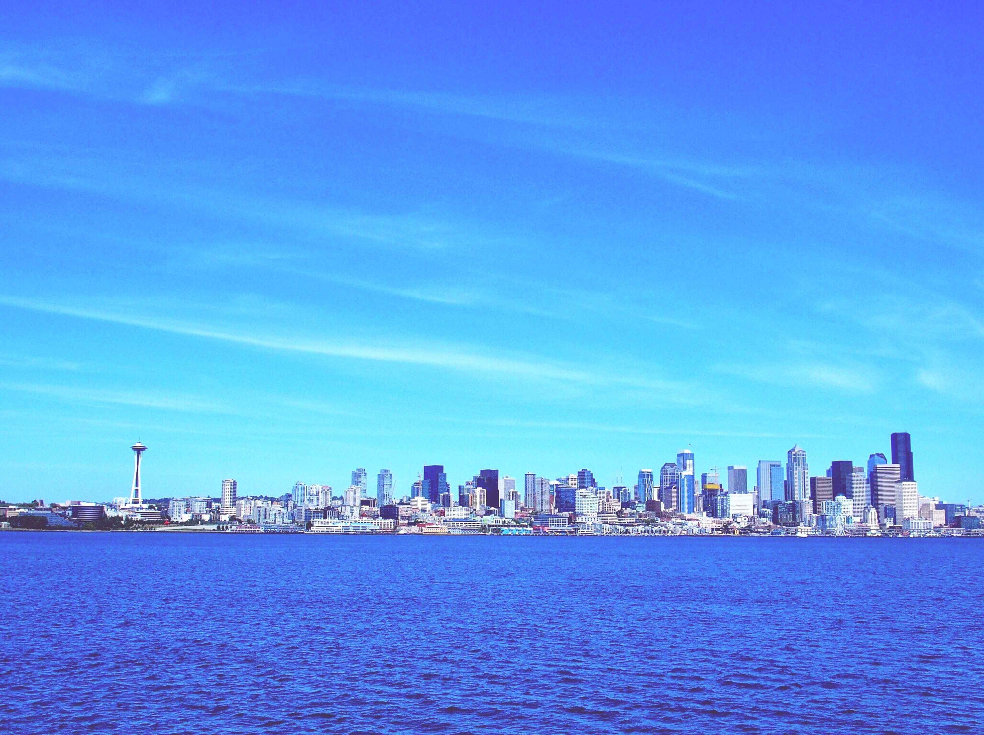 architecture, skyscraper, building exterior, cityscape, built structure, city, sky, blue, waterfront, urban skyline, sea, day, water, outdoors, no people, downtown district, modern, nature