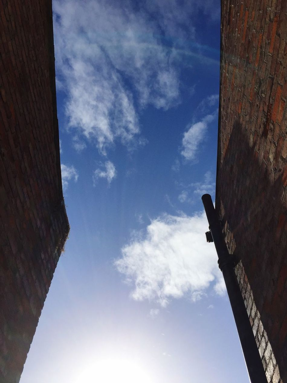 Sonne in Belfast. Northern Ireland Belfast Architecture Sky Tunnel View Silverlining Cloud Historic Hope Optimism Tall Lookingup Looking Into The Future Looking Forward Sun Escape Built Structure Building Exterior Brick Building Blue Stuck Breaking Free New Life