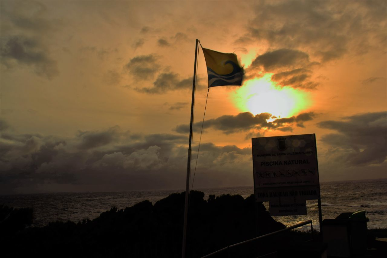 Capturing Flag Motion... Beach Beauty In Nature Capturing Movement Capturing The Moment Cloud - Sky Clouds And Sky Contrasting Colors Day Double Layer Clouds Flag Horizontal Motion Capture Nature No People Outdoors Sea Signboard Sky Stormy Skies Stormy Weather Water