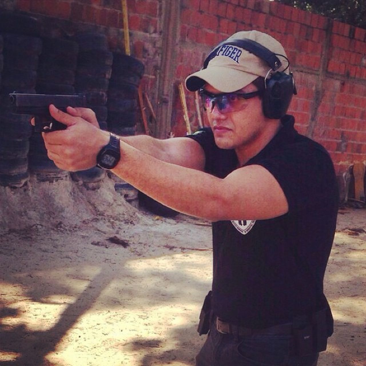 gun, aiming, protective eyewear, handgun, sunglasses, weapon, one person, ear protectors, standing, shooting a weapon, young adult, real people, outdoors, competition, sport, men, adult, human hand, day, people, adults only