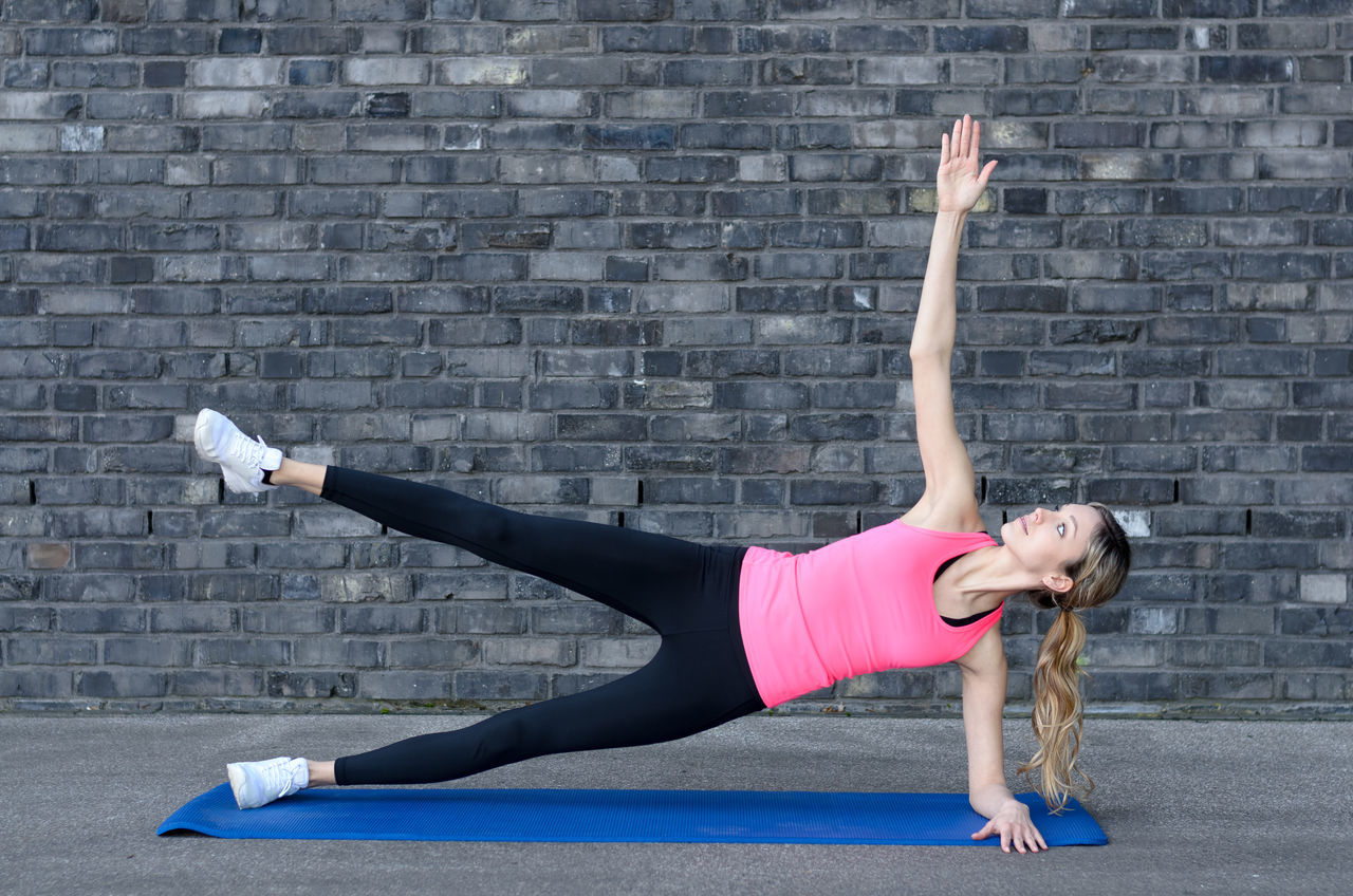 Adult Adults Only Athlete Exercise Equipment Exercising Flexibility Full Length Gym Healthy Lifestyle Human Arm Human Body Part Lifestyles Mid Adult One Person One Woman Only Only Women People Relaxation Exercise Self Improvement Sport Sports Clothing Sports Training Strength Vitality Wellbeing