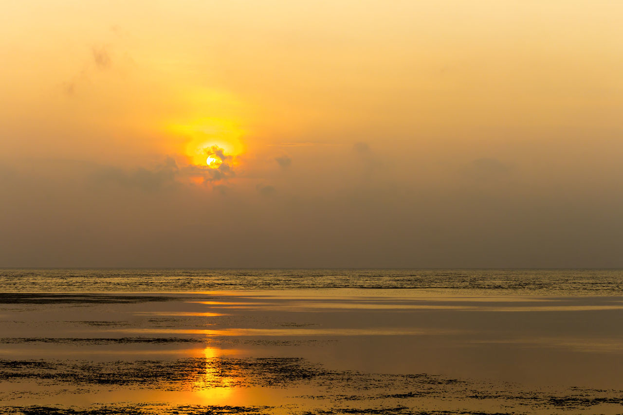Beginning sunrise over seashore Beach Beauty In Nature Beginning Coastline Dramatic Morning Nature Outdoors Peaceful Reflection Romantic❤ Scenics Sea Seashore Sky Summer Sun Sunlight Sunrise Tranquility Travel Destinations Visible Water