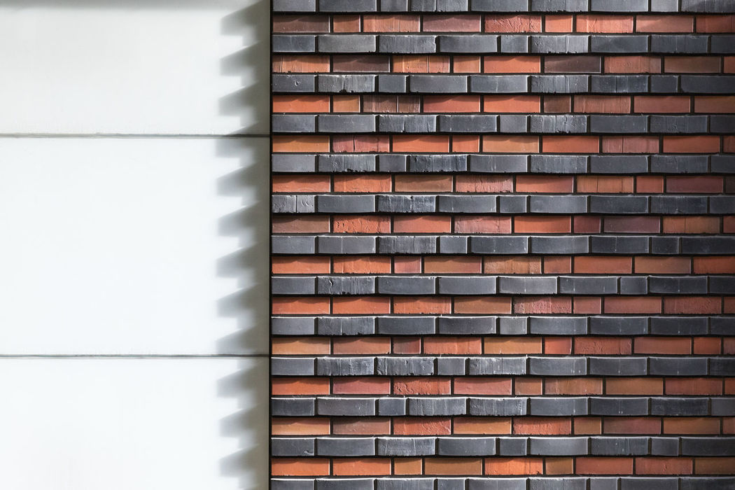 Shadow of bricks (zigzag-like) on a white wall Architecture Backgrounds Black Color Brick Brick Wall Building Exterior Built Structure Close-up Copy Space Day Full Frame Geometric Shape Light - Natural Phenomenon Natural Light No People Orange Color Pattern Rectangle Repetition Shadow Striped Sunny Textured  White Color Zigzag The Architect - 2017 EyeEm Awards
