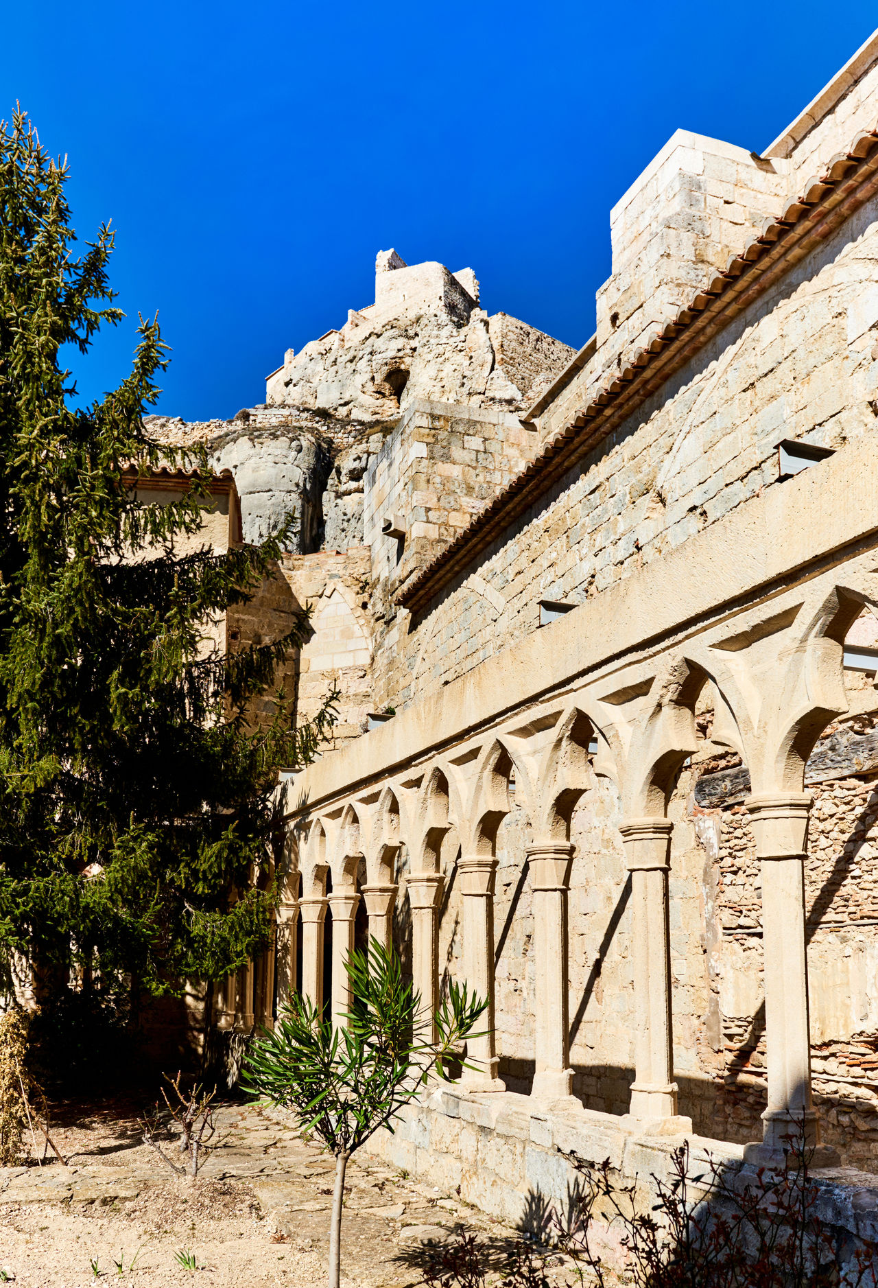 Castle of Morella, province of Castellon, Valencian Community, Spain. Morella Castle was declared a monument of artistic and historical importance. Ancient Architecture Arabic Architecture Blue Sky Castellón Castle Defensive Europe Fortification Fragment Gothic Architecture Heritage Building History Landmark Maestrazgo Medieval Architecture Monument Morella Nobody Old Ruin Outdoors Part Ruined Castle SPAIN Sunny Day Travel Destinations