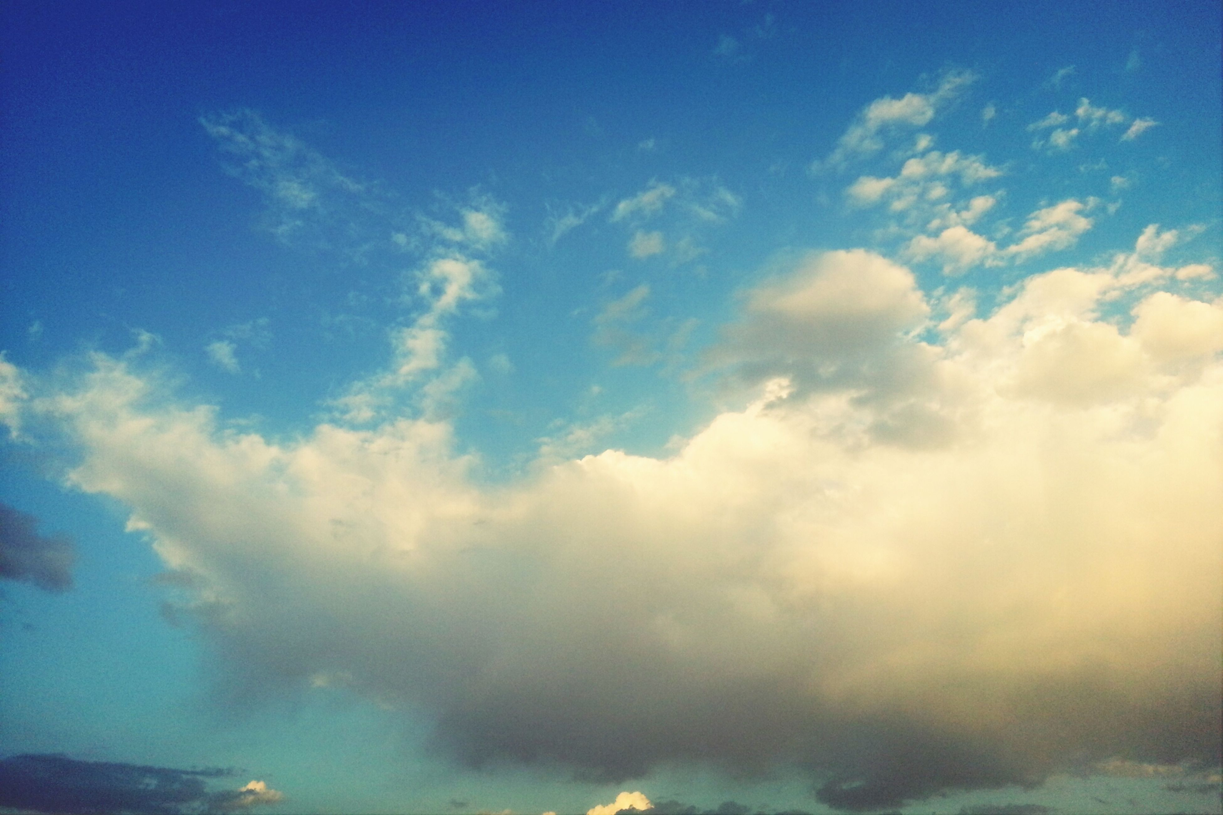 sky, blue, cloud - sky, beauty in nature, low angle view, sky only, scenics, tranquility, nature, tranquil scene, cloudscape, cloud, cloudy, idyllic, backgrounds, outdoors, white color, no people, majestic, day