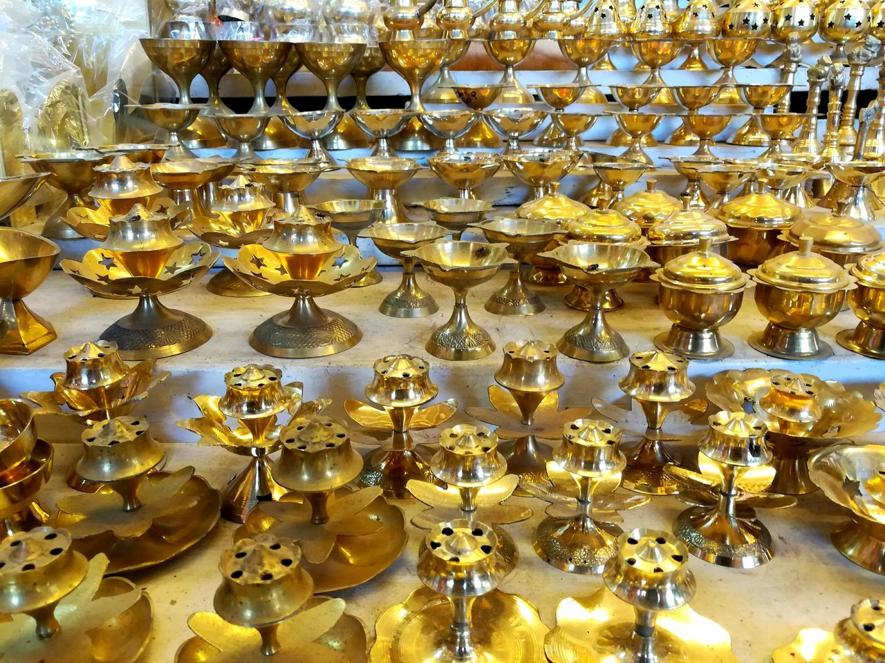 Large Group Of Objects Abundance Hanging Gold Gold Colored No People Luxury Indoors  Close-up Cultures Eyeem Market Random Photo Time Eyem Best Shots Eyeemphotography EyeEm Best Edits Eyem Gallery Outdoor Beauty Beautiful Colorfull Indian Culture  Indian Culture  India_clicks Day Arrangement Stack