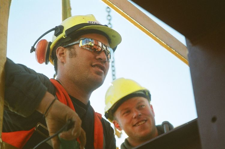 We can do this Bonding Construction Work Crane Work Day Focus On Foreground Headshot High Rise Building Sunglasses Young Men