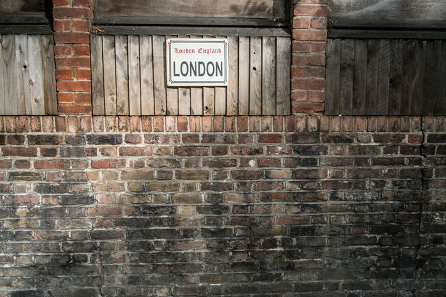 Notting hill Architecture Brick Wall Building Exterior Built Structure Communication Day Exit Sign Horizontal No Parking Sign No People Outdoors Text Warning Sign Weathered