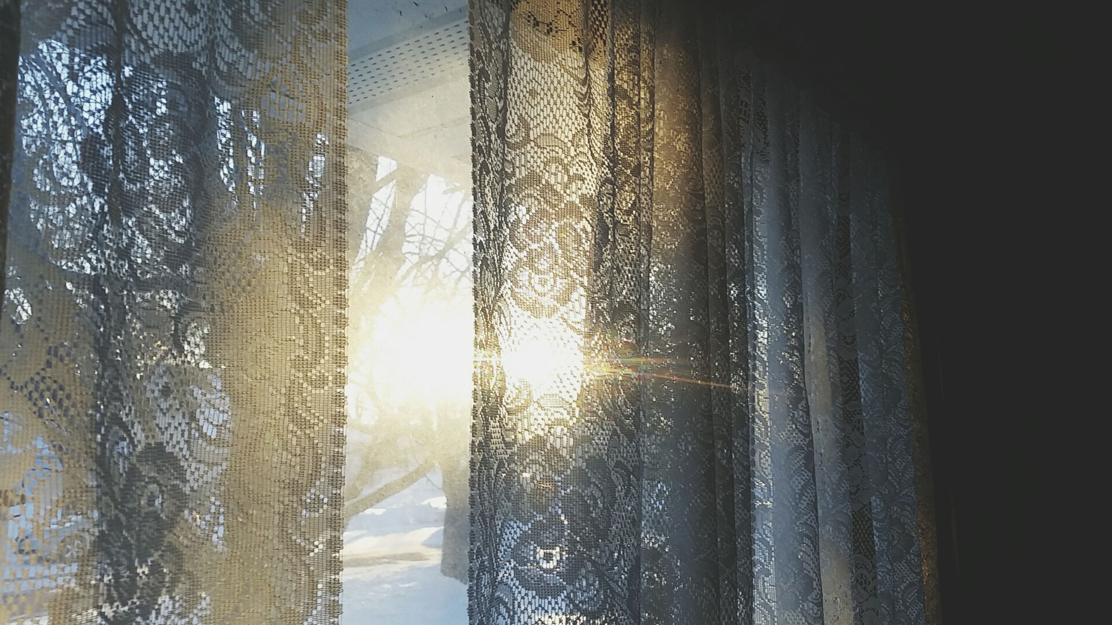 sunlight, window, sun, indoors, water, reflection, glass - material, sunbeam, close-up, cold temperature, lens flare, built structure, transparent, curtain, sunset, no people, architecture, day, sky, nature