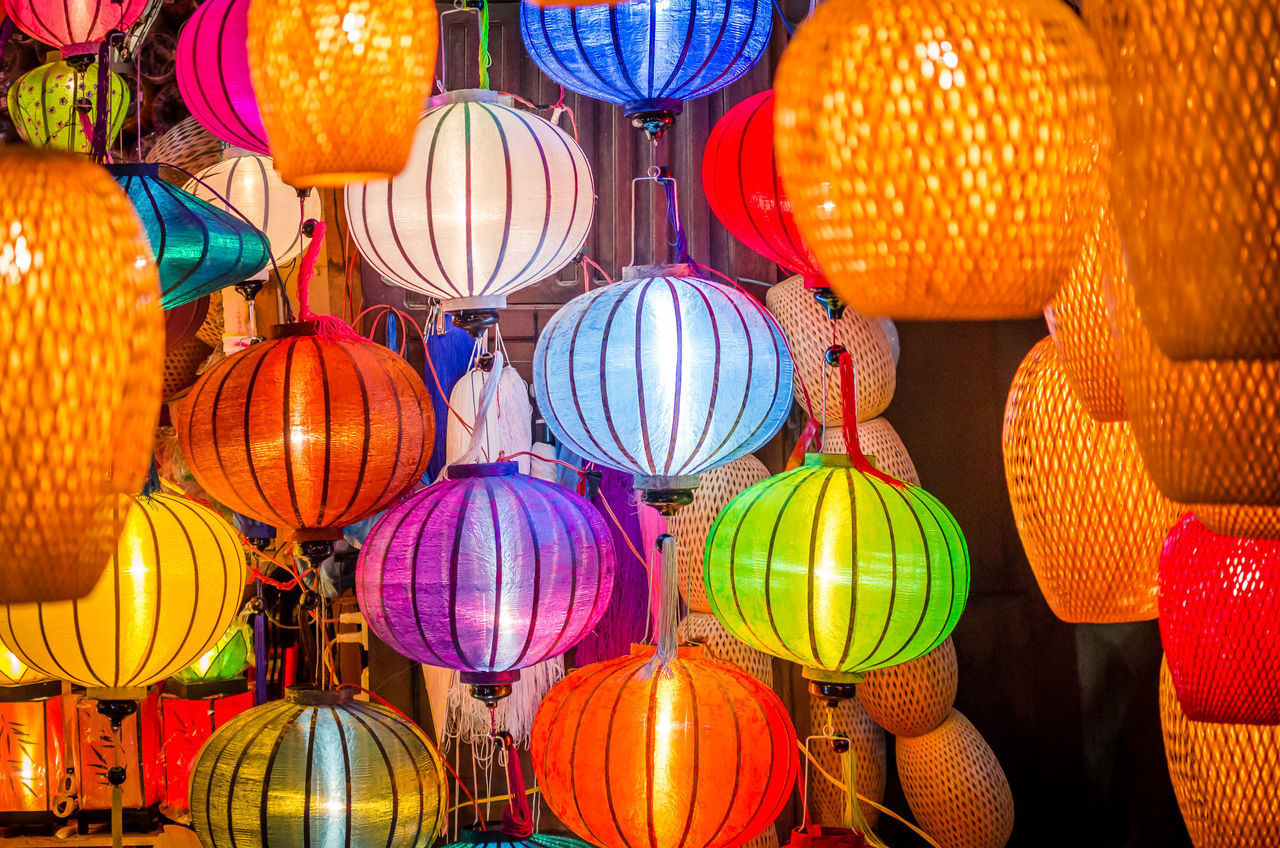 Beautiful colorful lanterns in Vietnam Choice Colorful For Sale Hanging Hoi An Illuminated Lamp Lantern Large Group Of Objects Market Market Multi Colored Night No People Old Oriental Red Retail  Variation Vietnam Yellow