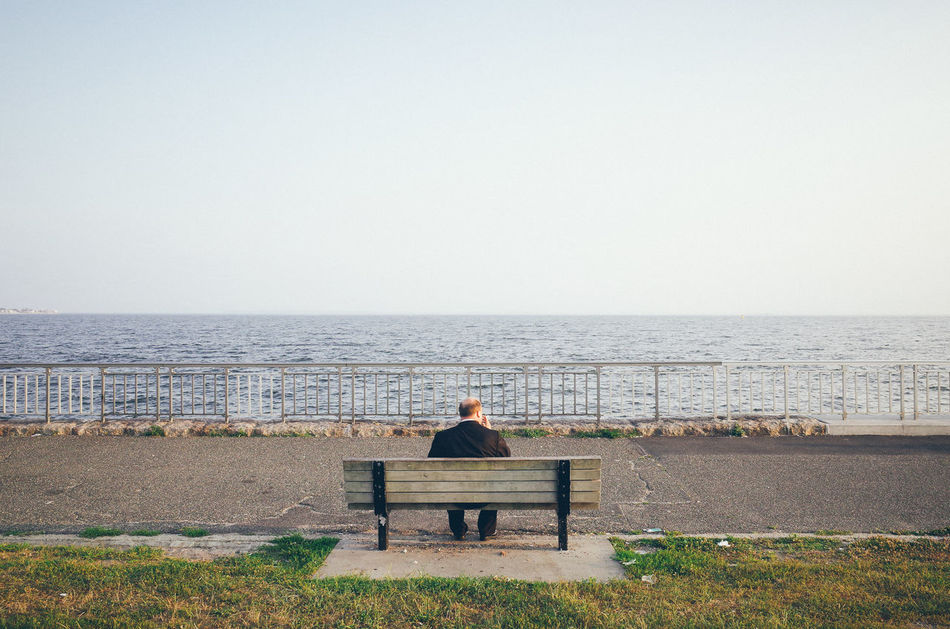 The world seen from behind Absence Backhead Behind Bench Getting Away From It All Horizon Lonely New York City Outdoors Park Bench Rear View Rear View Relaxation Sea The World Seen From Behind Water