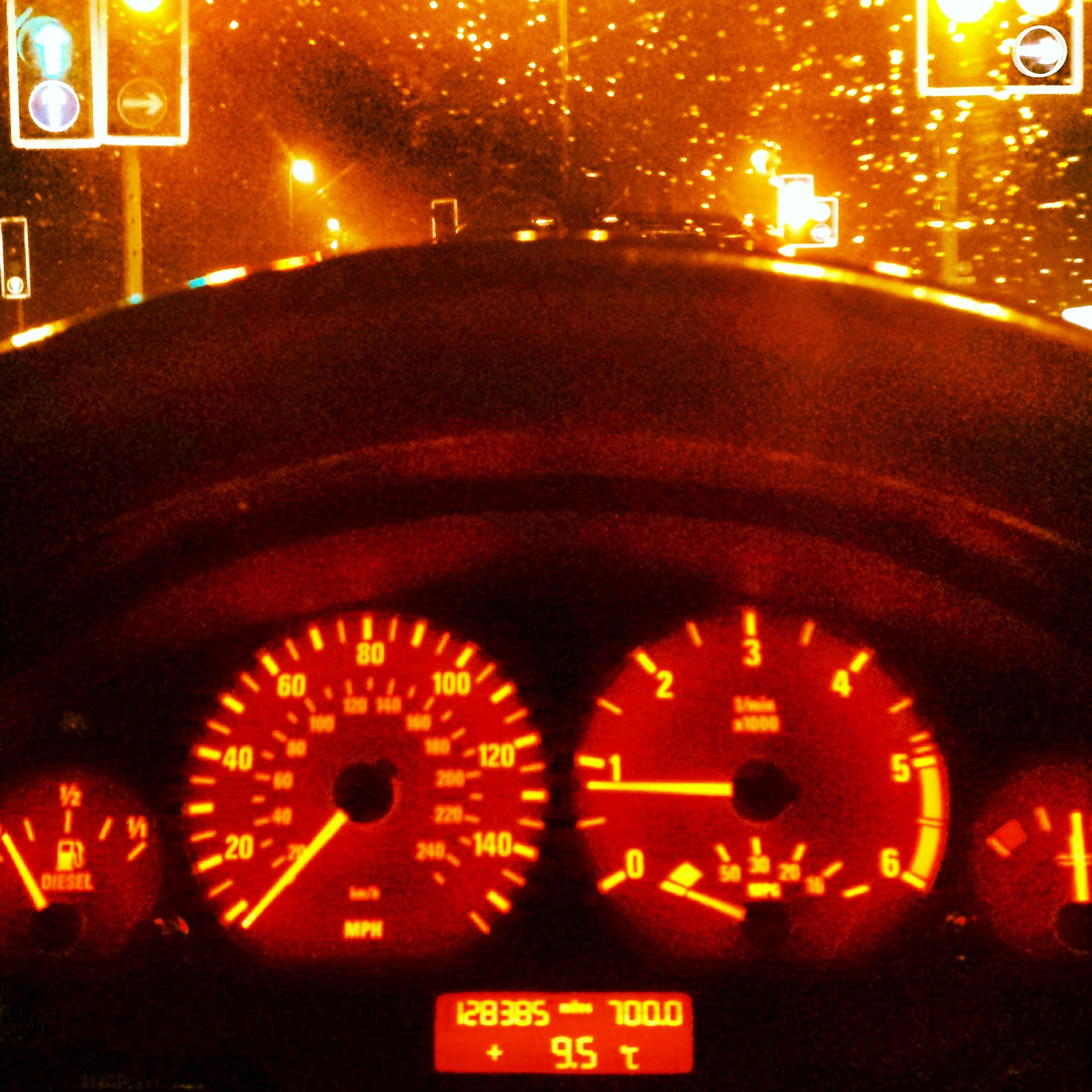 illuminated, night, transportation, text, mode of transport, land vehicle, car, communication, street, lighting equipment, number, road, western script, glowing, headlight, information sign, no people, guidance, light - natural phenomenon, speed