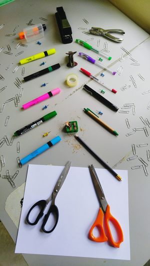 Indoors  Large Group Of Objects High Angle View Close-up Multi Colored Geometric Shape Order Arrangement Tacks Paperpunch Stapler Rulers Tape Highlighters Paperclips Markers  Sharpener Pencil Pens Markers  Scissors Markers  The Colour Of School Stationary Group Of Objects