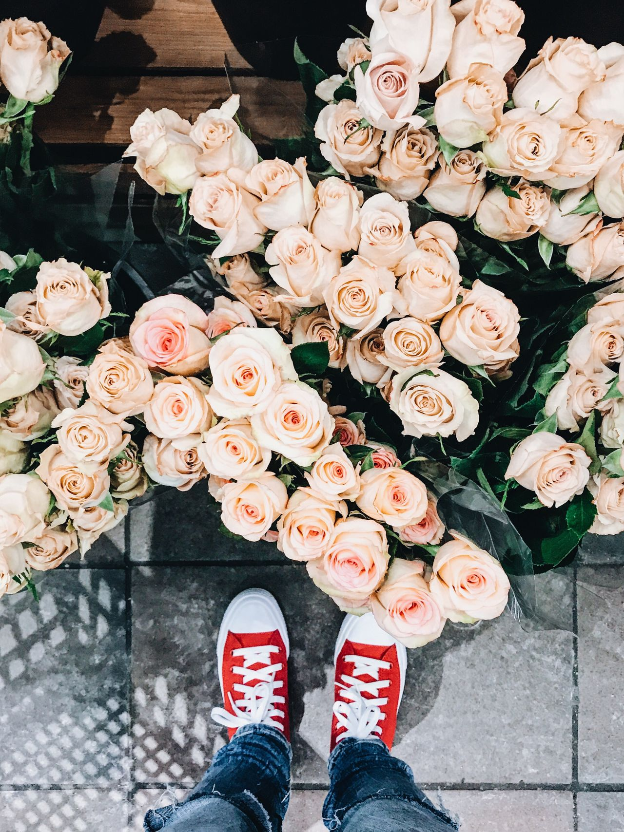Flower Standing Choice Freshness Shoe High Angle View Low Section Real People Outdoors Variation Human Leg Fragility Multi Colored Beauty In Nature Flower Head Day One Person Nature Canvas Shoe Human Body Part