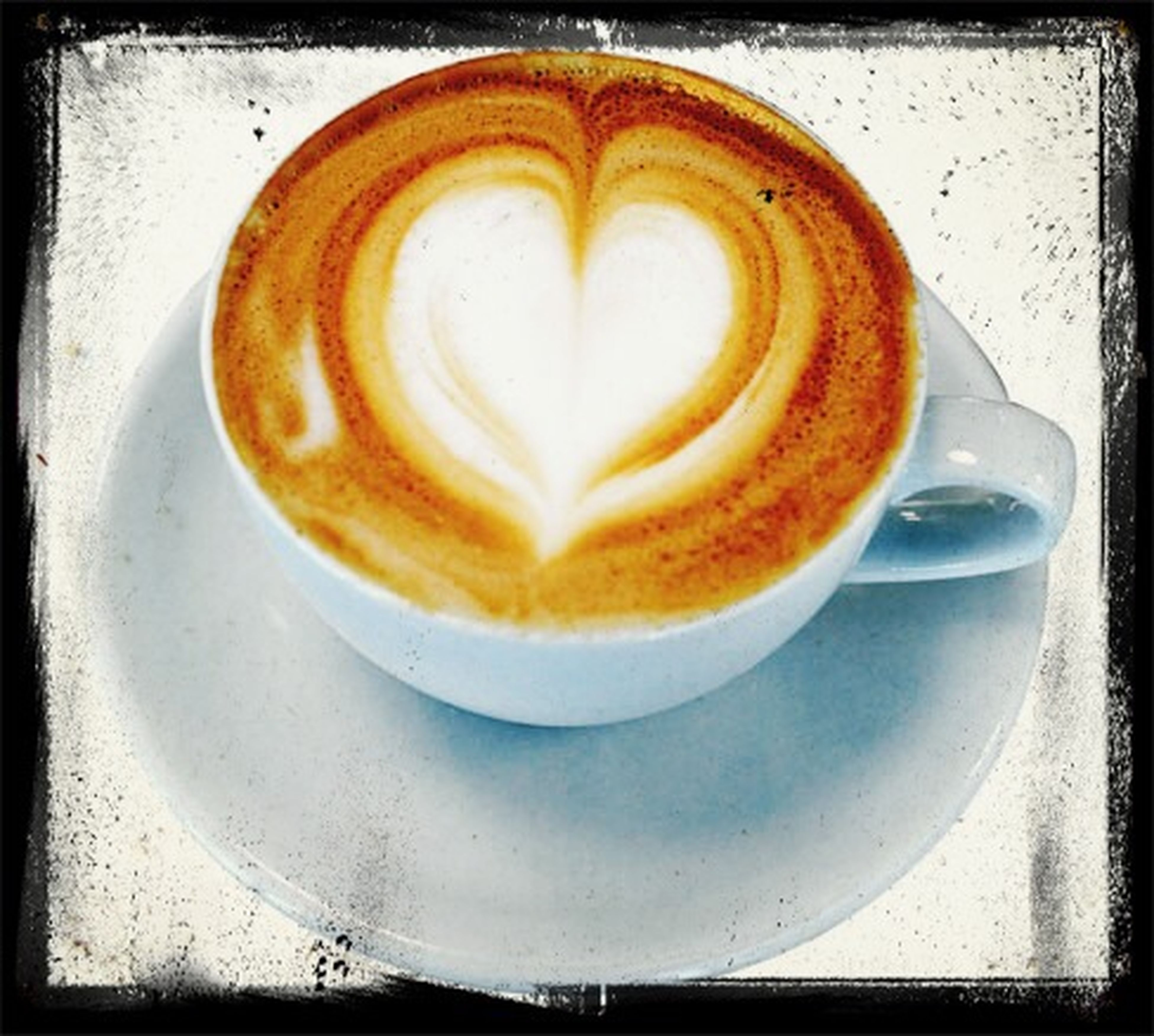 food and drink, coffee cup, coffee - drink, froth art, refreshment, drink, frothy drink, cappuccino, indoors, saucer, freshness, table, still life, coffee, close-up, heart shape, high angle view, latte, art, creativity