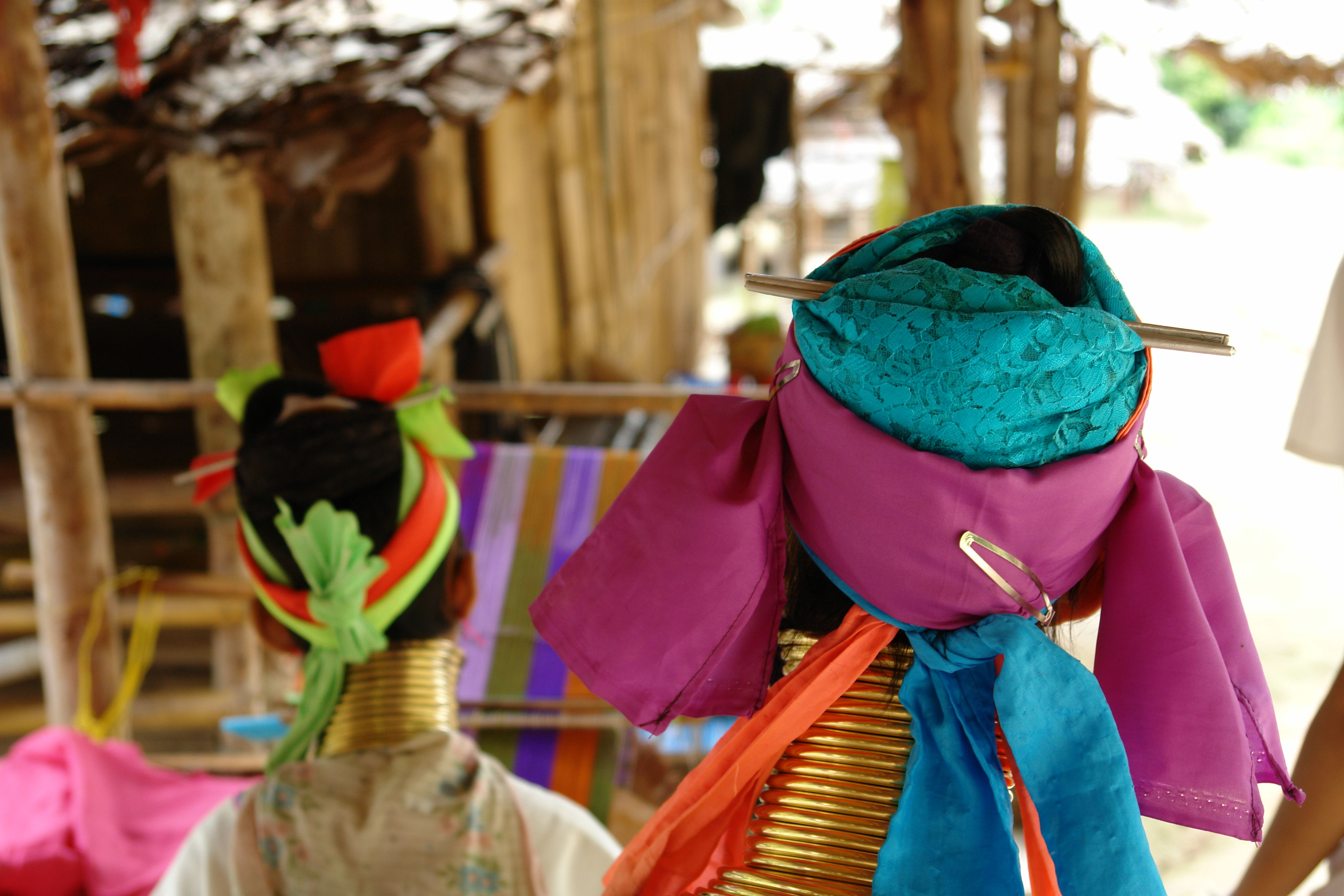 focus on foreground, multi colored, rear view, clothing, hanging, lifestyles, person, leisure activity, traditional clothing, indoors, day, men, textile, casual clothing, childhood, fabric, sitting, clothesline