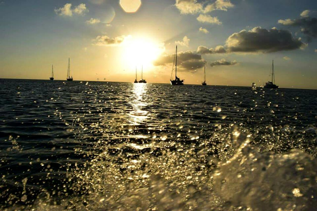 Sea Sunset Nautical Vessel Horizon Over Water Sun Water Cloud - Sky Tropical Climate Ship Vacations Sky Silhouette Outdoors Travel Summer Nature Honduras