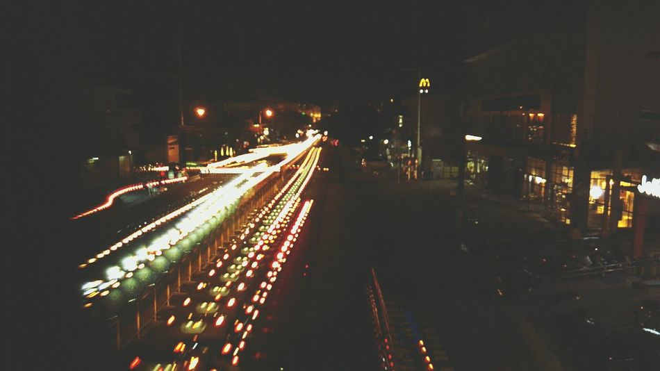 Exposure Illuminated Traffic Car City Transportation Outdoors Night Road No People Beauty In Nature Closing Plant Freshness Springtime Close-up Petal Day Flower Head