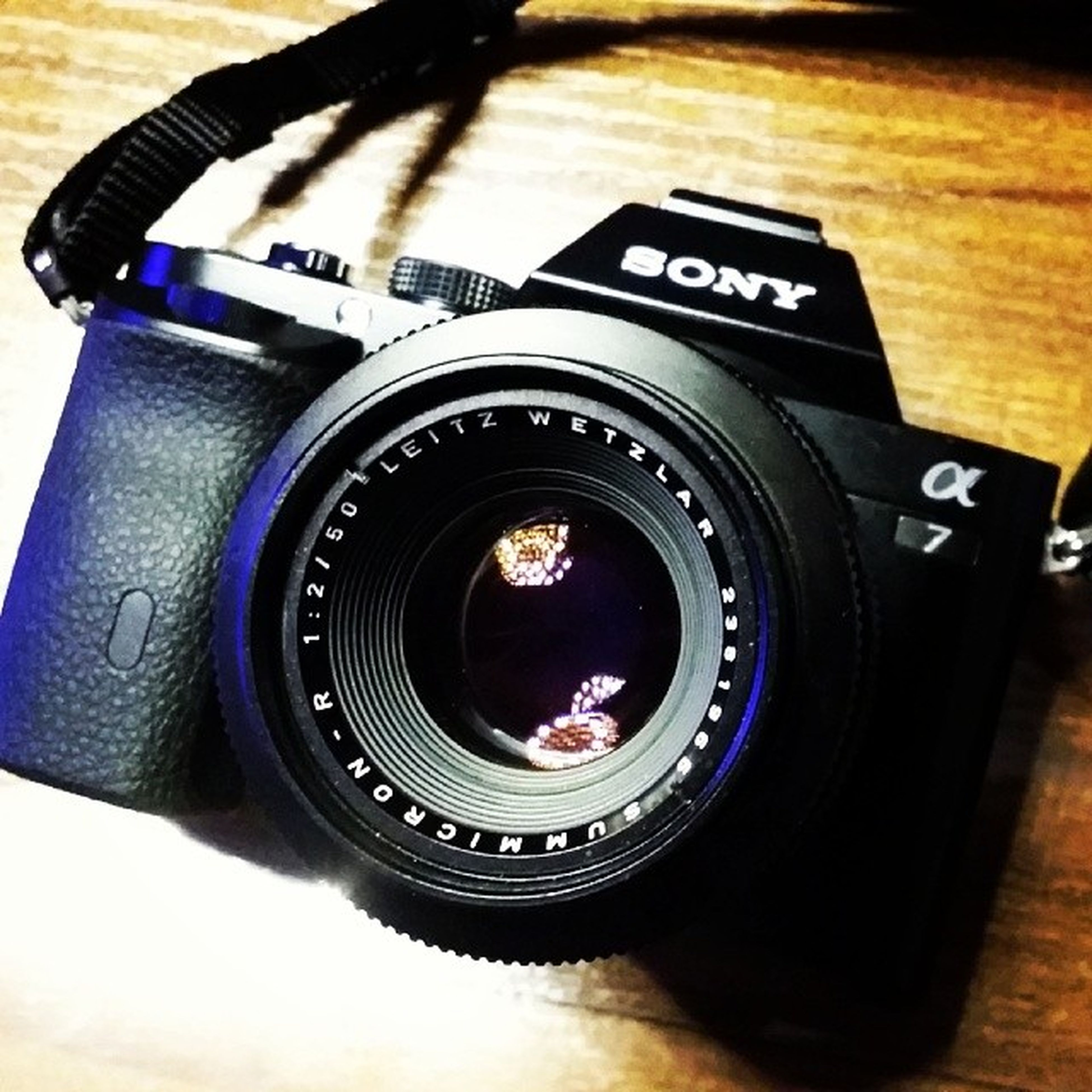 technology, communication, indoors, camera - photographic equipment, photography themes, close-up, text, wireless technology, photographing, number, retro styled, time, digital camera, part of, focus on foreground, lens - optical instrument, old-fashioned, western script, smart phone, music