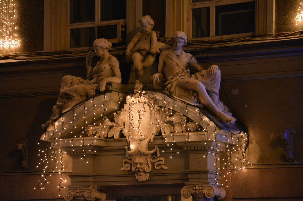 statue, sculpture, human representation, illuminated, art and craft, arts culture and entertainment, low angle view, night, architecture, indoors, no people