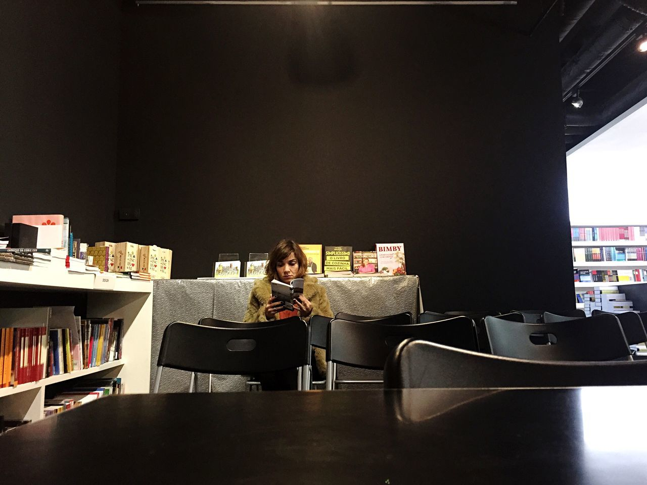 Sitting Chair Young Adult Women Real People Reading A Book Riding Library Book Store Quiet Silence Focus