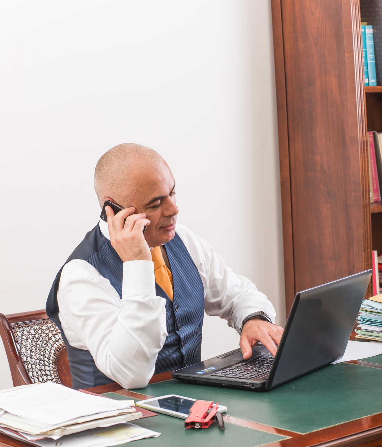 Adults Only Balding Business Business Finance And Industry Businessman Button Down Shirt Completely Bald Connection Desk Eyeglasses  Hair Loss Internet Laptop Mature Adult Mature Men Men One Man Only One Mature Man Only One Person Only Men Shaved Head Sitting Technology Using Laptop Wireless Technology