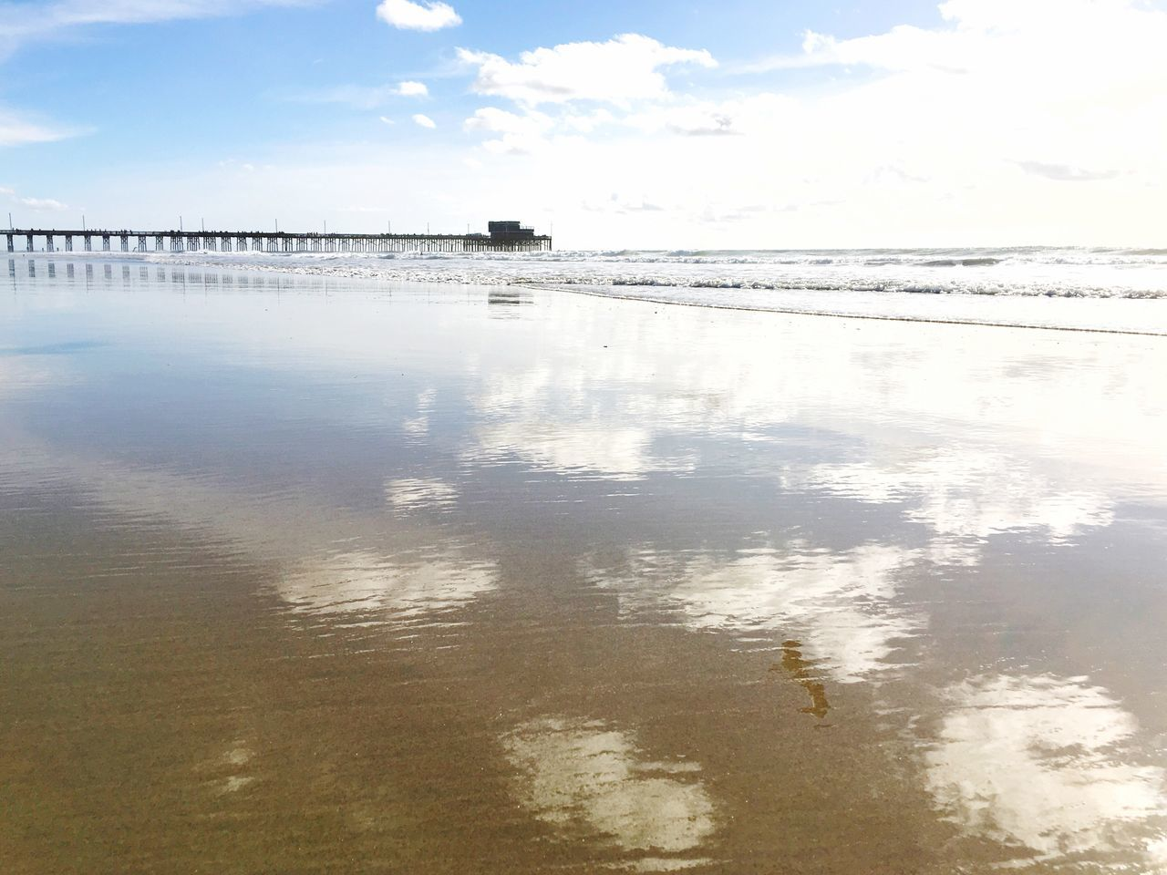 Cloud reflections Ocean View Clouds And Sky Water Reflection Nature Sky Sea Beauty In Nature Tranquil Scene Tranquility No People Outdoors Waterfront Beach Horizon Over Water Architecture Low Tide Revelations Reflections In The Water Rippled Water