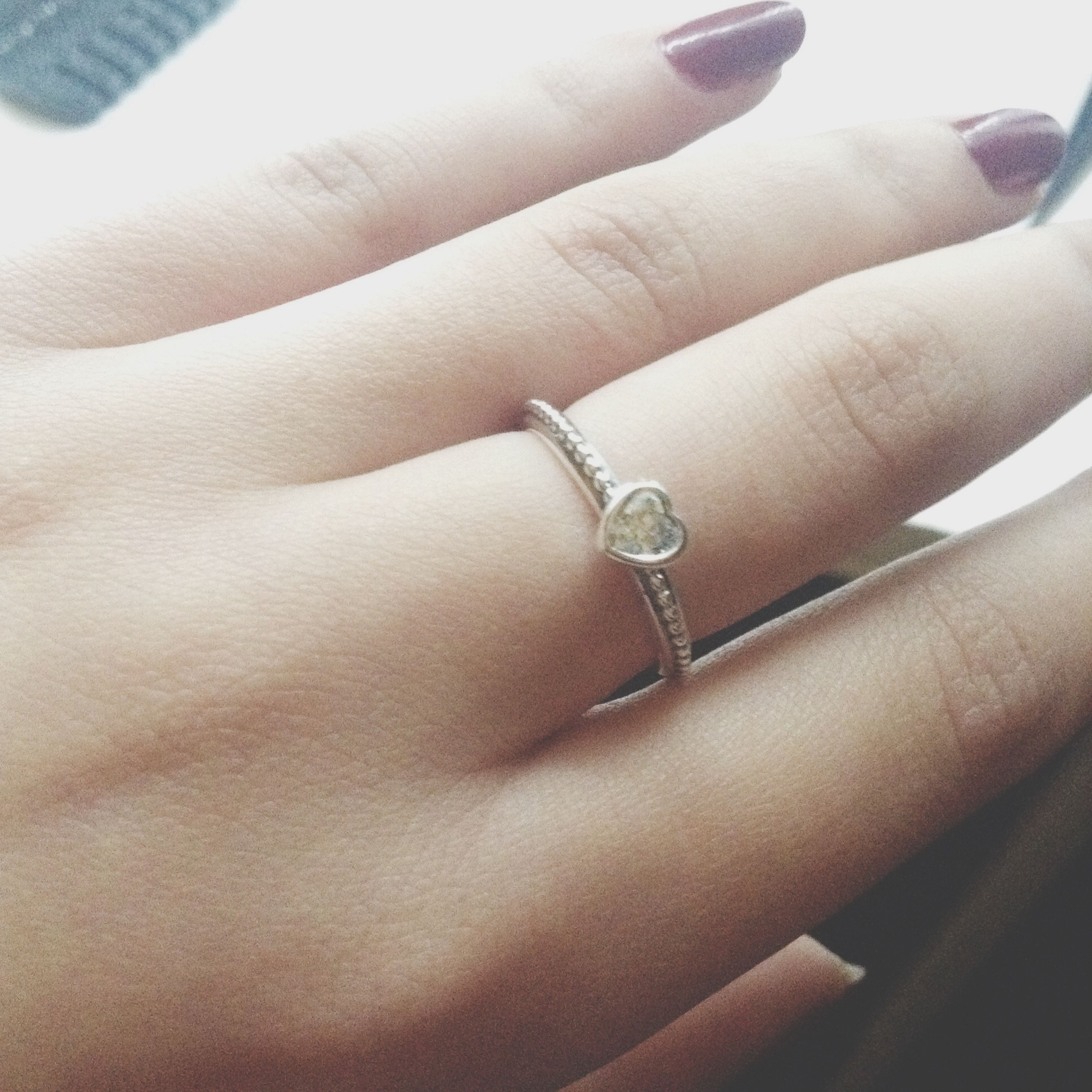 person, indoors, part of, cropped, close-up, human finger, lifestyles, high angle view, femininity, human skin, unrecognizable person, low section, holding, personal perspective, ring