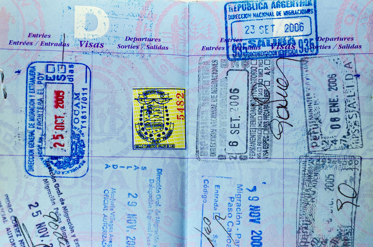 Closeup view of well used passport pages and stamps America Background Business Country Customs Destination Document Id Identification Identity Immigration International Official Pass Passport Security Stamp Tourism Travel USA Vacation Visa White World ınternational