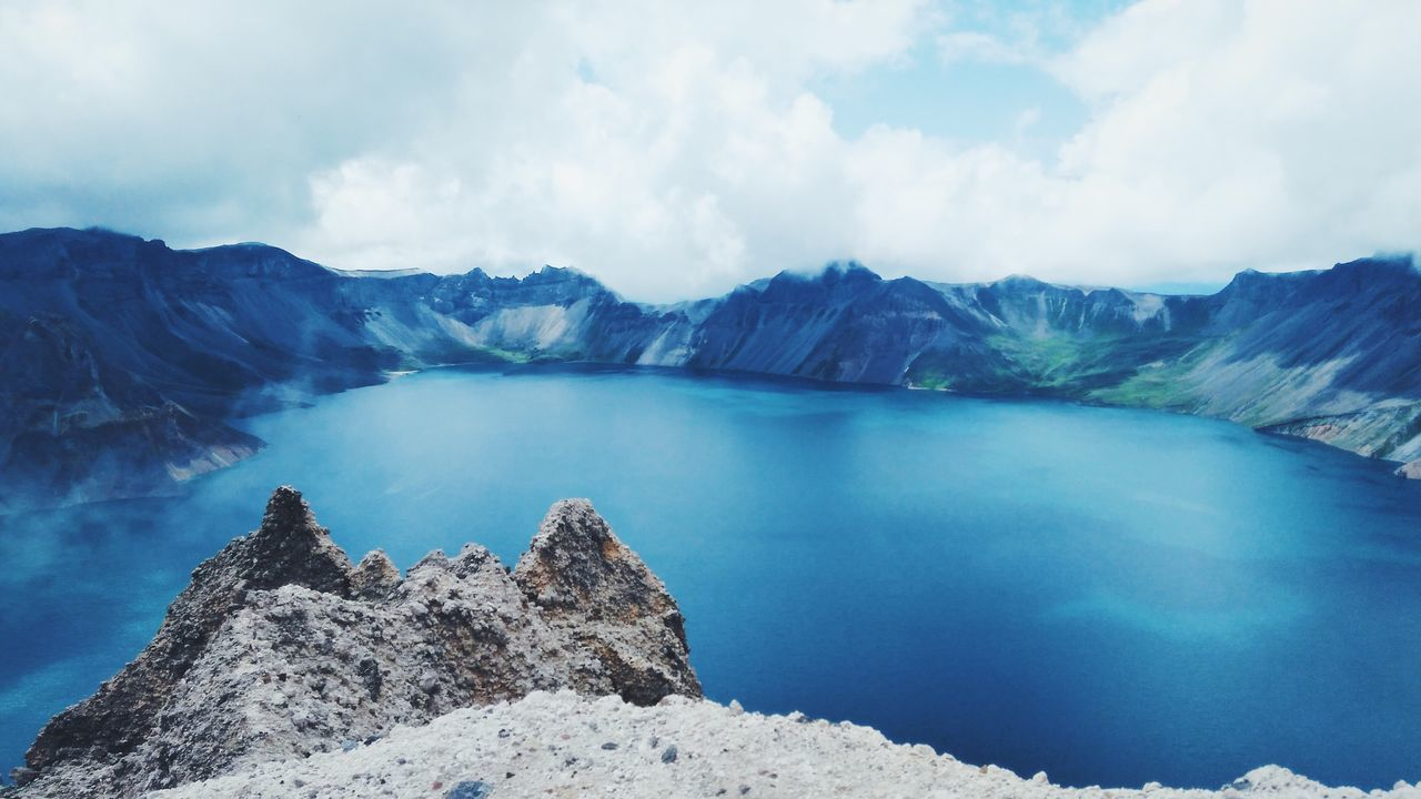 scenics, beauty in nature, mountain, nature, sky, tranquility, tranquil scene, water, idyllic, day, no people, physical geography, cloud - sky, outdoors, lake, mountain range, landscape