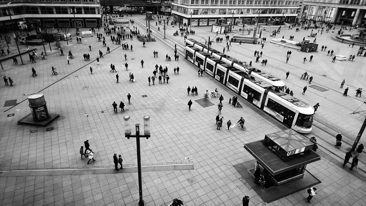 Watching the people from above Large Group Of People High Angle View Lifestyles Outdoors Leisure Activity Day People Crowd Adults Only Adult Black And White Blackandwhite Berliner Ansichten My Fuckin Berlin Streetphotography Tram Looking Down Arial View Arial Photography